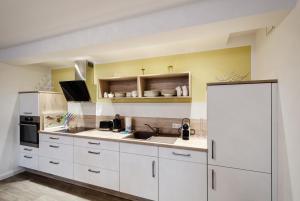 Küche/Küchenzeile in der Unterkunft FeWo Prora - Sanddüne