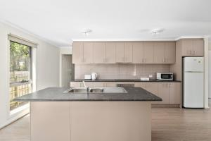 A kitchen or kitchenette at Phillip Island Luxurious Retreat