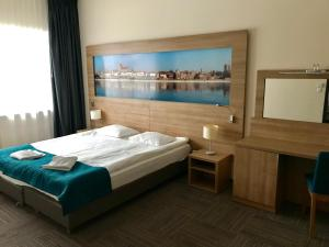 A bed or beds in a room at Hotel Meeting