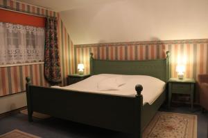 Ein Bett oder Betten in einem Zimmer der Unterkunft Alex Maja