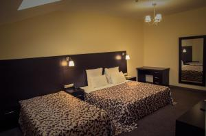 A bed or beds in a room at Gorki Apartments Domodedovo
