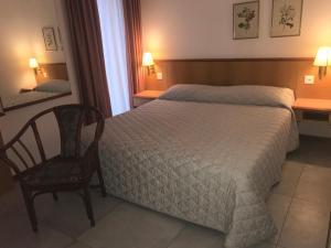 Ein Bett oder Betten in einem Zimmer der Unterkunft Albergo Nazionale