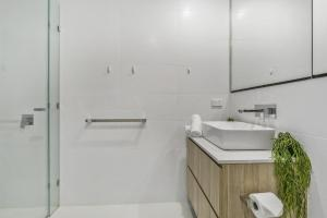A bathroom at New One-Bedroom with Sweeping Views