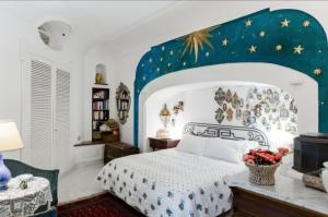 A bed or beds in a room at CASA MIA - with shared pool and parking space