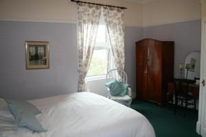 A bed or beds in a room at The Old Rectory