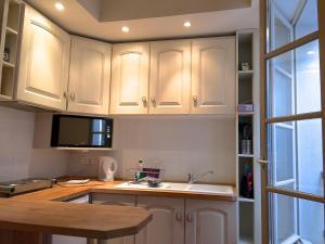 A kitchen or kitchenette at myperpignan apartments
