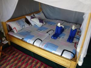 A bed or beds in a room at Crocodile Camp-Masai Mara