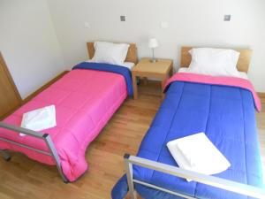 A bed or beds in a room at Azores Youth Hostels - Sao Jorge