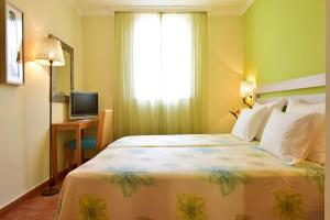A bed or beds in a room at Pestana Viking Beach & SPA Resort
