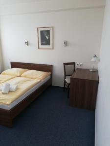 Posteľ alebo postele v izbe v ubytovaní Hotel Klar
