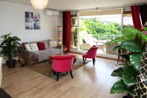 Uma área de estar em Residence Tahiri Appartement vue mer