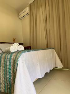 Cama ou camas em um quarto em Dunas de Marape