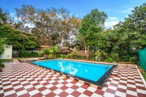 The swimming pool at or close to FabEscape Hillscape Villa Khandala