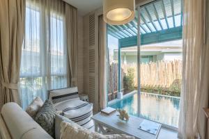 Ein Sitzbereich in der Unterkunft Cape Kudu Hotel, Koh Yao Noi