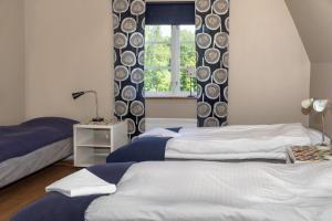 Säng eller sängar i ett rum på STF Skäralids Camping & Vandrarhem