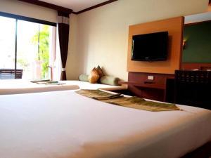 Voodi või voodid majutusasutuse Fanari Khaolak Resort - Fanari Courtyard Wing toas