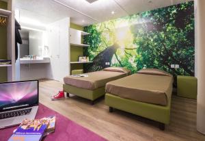 Ein Bett oder Betten in einem Zimmer der Unterkunft Jolly Camping In Town