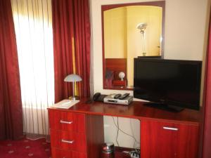 A television and/or entertainment center at Hotel Ary