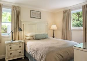 A bed or beds in a room at Anchorage by the Sea