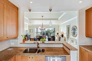 A kitchen or kitchenette at The Landings Resort and Spa - All Suites