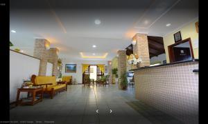 O saguão ou recepção de Hotel Xapuri