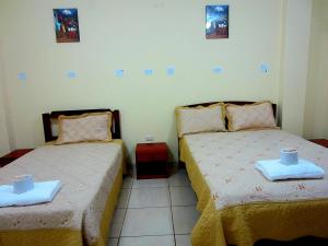 A bed or beds in a room at Sandel