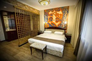 A bed or beds in a room at G Empire
