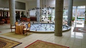 The swimming pool at or near Arta Palace