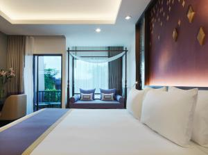 A bed or beds in a room at Chanalai Garden Resort, Kata Beach - SHA Plus