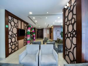 O saguão ou recepção de Olaya Houses 1