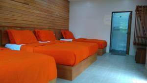 Cama o camas de una habitación en Naura Roomstay