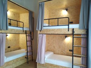 A bunk bed or bunk beds in a room at Welcome Hostel