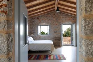 Ένα ή περισσότερα κρεβάτια σε δωμάτιο στο Ξενοδοχείο Αντάρης