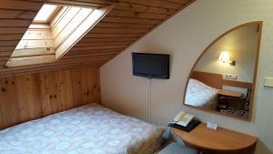Lova arba lovos apgyvendinimo įstaigoje Home B&B