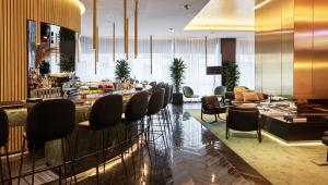 A restaurant or other place to eat at Roomers Munich, Autograph Collection