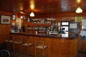 The lounge or bar area at The Neuk