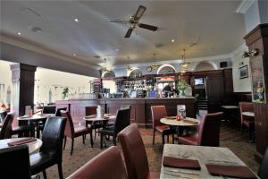 A restaurant or other place to eat at Fairway Hotel
