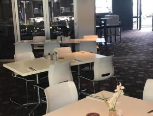 The lounge or bar area at The Premier Hotel Broadmeadow