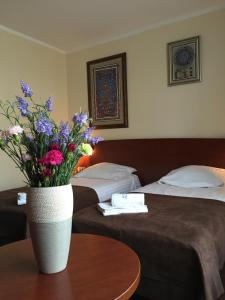A bed or beds in a room at Gaja