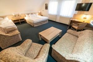 Ein Sitzbereich in der Unterkunft Pension & Restaurant Nordstern