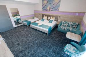 Postel nebo postele na pokoji v ubytování Wellness Hotel Katalin