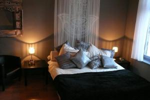 A bed or beds in a room at Hotel Matuchi
