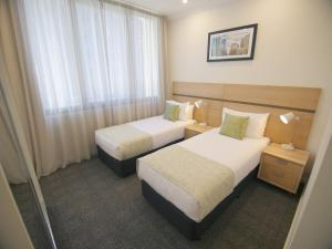 A bed or beds in a room at Quality Apartments Adelaide Central