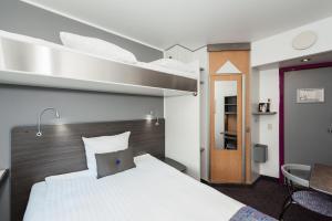 Een bed of bedden in een kamer bij Cabinn Scandinavia