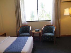 A bed or beds in a room at Sea View Resort Hotel & Apartments