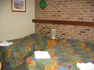 A bed or beds in a room at Gisborne Motel