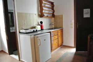 Kuchnia lub aneks kuchenny w obiekcie Andreas Studios