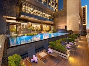 The swimming pool at or near The Leela Ambience Convention Hotel Delhi