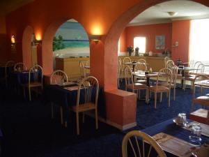 Restaurant ou autre lieu de restauration dans l'établissement Royal Islander Hotel
