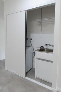 A kitchen or kitchenette at TiTree Village Holiday Apartments